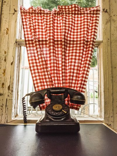 Telephone on window sill at home