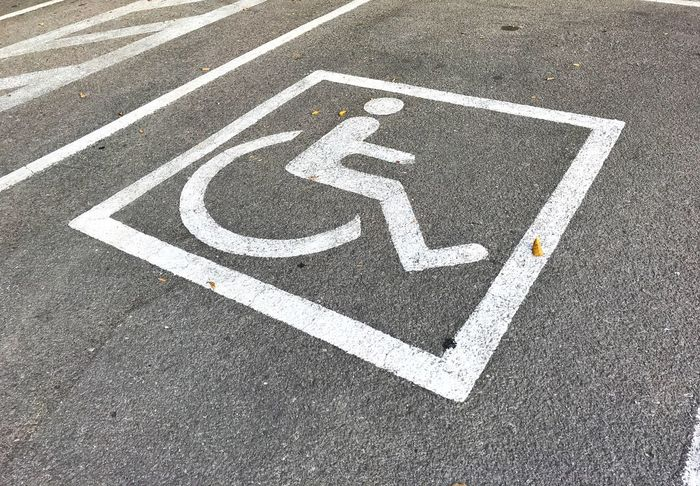 Parking Lot WhellChair Asphalt Communication Day Differing Abilities Disabled Access Disabled Sign Guidance High Angle View Human Representation Marking Medical Equipment No People Outdoors Representation Road Road Marking Sign Symbol Symbols Transportation Wheelchair White Color