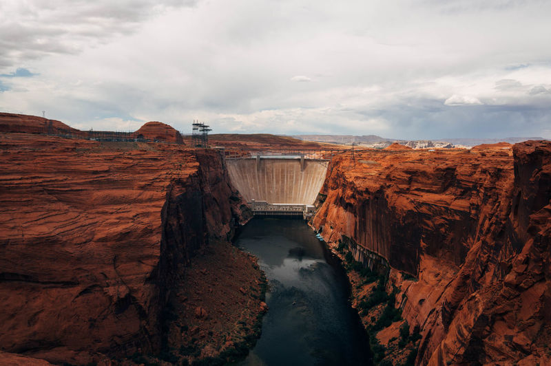 Arizona Glen Canyon Dam Beauty In Nature Cloud - Sky Dam Day Environment Eroded Hydroelectric Power Nature No People Non-urban Scene Outdoors Power In Nature Rock Rock - Object Rock Formation Scenics - Nature Sky Solid Tranquil Scene Tranquility Travel Destinations Water