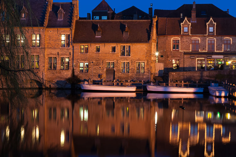 Bruges canal at dusk West Flanders Architecture Belgium Boat Bruges Brugge Building Exterior Built Structure Canal Canals And Waterways City Dusk Europe Houses Illuminated Illuminated Building Nautical Vessel Night No People Outdoors Reflection Reflection Rozenhoedkaai Water Waterfront