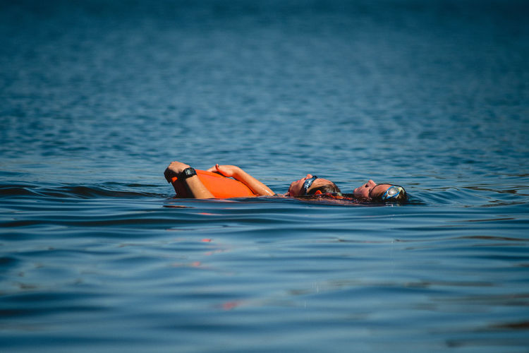 Water Waterfront Swimming Sea Day Nature Floating Floating On Water Rippled Outdoors Lying Down Selective Focus Men Trip Inflatable  Real People Leisure Activity Vacations Pool Raft