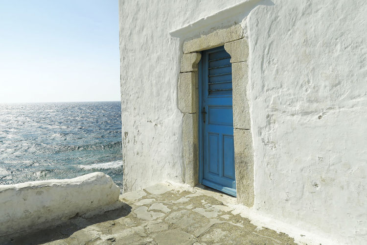 Door to summer. A blue door on a whitewashed wall in Mykonos, Greece. The entrance to one of the five churches that form The Church of Panagia Paraportiani. Aegean Architecture Blue Greek Greek Islands Greek Summer Holiday Idyllic Island Blue Door Live For The Story Mykonos Mykonos Island Mykonos,Greece Paraportiani Church Mykonos Sea And Sky Seascape Summer Sunny Tourism Tranquility Travel Vacations White Whitewashed Whitewashed Walls