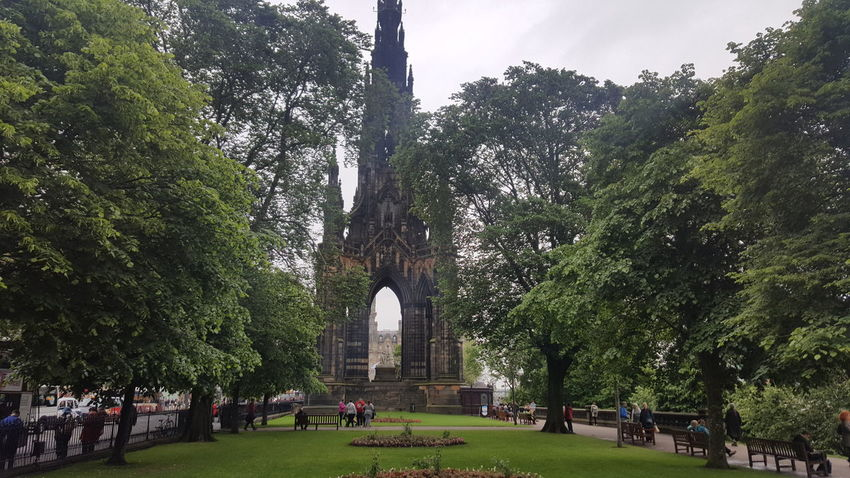 "The Scott Monument is a Victorian Gothic monument to Scottish author Sir Walter Scott. It is the largest monument to a writer in the world. It stands in Princes Street Gardens in Edinburgh, opposite the Jenners department store on Princes Street and near to Edinburgh Waverley Railway Station, which is named after Scott's Waverley novels. The tower is 200 feet 6 inches (61.11 m) high, and has a series of viewing platforms reached by a series of narrow spiral staircases giving panoramic views of central Edinburgh and its surroundings. The highest platform is reached by a total of 287 steps (those who climb the steps can obtain a certificate commemorating their achievement). It is built from Binny sandstone quarried near Ecclesmachan in West Lothian. In terms of its location, it is placed on axis with South St David Street, the main street leading off St Andrew Square to Princes Street, and is a focal point within that vista, its scale being large enough to totally screen the Old Town behind. As seen from the south side, Princes Street Gardens, its location appears more random, but it totally dominates the Eastern Section of the gardens, through a combination of its scale and elevated position relative to the sunken gardens. Following Scott's death in 1832, a competition was held to design a monument to him. An unlikely entrant went under the pseudonym ""John Morvo"", the name of the medieval architect ofMelrose Abbey. Morvo was in fact George Meikle Kemp, forty-five-year-old joiner, draftsman, and self-taught architect. Kemp had feared his lack of architectural qualifications and reputation would disqualify him, but his design (similar to an unsuccessful one he had earlier submitted for Glasgow Cathedral) was popular with the competition's judges, and in 1838 Kemp was awarded the contract to construct the monument. John Steell was commissioned to design a monumental statue of Scott to rest in the space between the tower's four columns. Steell's statue, made from white Carrara marble, shows Scott seated, resting from writing one of his works with a quill pen and his dog Maida by his side. The monument carries 64 figures (carried out in three phases) of characters from Scott's novels by a variety of Scots sculptors including, Alexander Handyside Ritchie, John Rhind, William Birnie Rhind, William Brodie, William Grant Stevenson, David Watson Stevenson, John Hutchison,George Anderson Lawson, Thomas Stuart Burnett, William Shirreffs, Andrew Currie, George Clark Stanton, Peter Slater, and two female representatives, Amelia Robertson Hill (who also made the statue of David Livingstone immediately east of the monument), who contributed three figures to the monument, and the otherwise unknown Katherine Anne Fraser Tytler. The foundation stone was laid on 15 August 1840. Following permission by an Act of Parliament (the Monument to Sir Walter Scott Act 1841 (4 & 5 Vict.) C A P. XV.), construction began in 1841 and ran for nearly four years. The tower was completed in the autumn of 1844, with Kemp's son placing the finial in August of the year. The total cost was just over £16,154. When the monument was inaugurated on 15 August 1846, George Meikle Kemp himself was absent; Kemp having fallen into the Union Canal while walking home from the site on the foggy evening of 6 March 1844 and drowned. In total (excluding Scott and his dog) there are 68 figurative statues on the monument of which 64 are visible from the ground. Four figures are placed above the final viewing gallery and are only visible by telephoto or (at a very distorted angle) from the viewing gallery itself. In addition, eight kneeling Druid figures support the final viewing gallery. There are 32 unfilled niches at higher level. Sixteen heads of Scottish poets and writers appear on the lower faces, at the top of the lower pilasters. The heads (anti-clockwise from the NW) represent: James Hogg; Robert Burns; Robert Fergusson; Allan Ramsay; George Buchanan; Sir David Lindsay; Robert Tannahill; Lord Byron; Tobias Smollett; James Beattie; James Thomson; John Home; Mary, Queen of Scots; King James I of Scotland; King James V of Scotland; and William Drummond of Hawthornden. In total, 93 persons are depicted, plus two dogs and a pig. In the early 1990s it was proposed that the stonework should be cleaned. There were views for and against cleaning and a scientific/geological investigation, including cleaning trials on samples of stone, was carried out. It was decided not to clean the stone due to the damage it would sustain. A restoration programme was undertaken involving replacing old repairs and damaged areas with Binny stone for which purpose the original quarry was re-opened. The fresh stonework contrasts with the smoke-darkened original. The overall cost of the restoration was £2.36 million and was funded by the Heritage Lottery Fund, Historic Scotland and the City of Edinburgh Council. The monument is now administered by the Culture and Sport division of the City of Edinburgh Council. The monument is featured prominently in the movie Cloud Atlas, as a location which the character Robert Frobisher frequents. Architecture Architecture & Statues Architecture Details Architecture Facade Architecture Photography Architecture_bw Architecture_collection Architecturelovers Architectureporn EyeEm Best Shots From My Point Of View Gothic Gothic Architecture Hidden Gems  Historical Monuments Landscape Princes Street Princes Street Gardens Scotland Scott Scott Monument Scottish Victorian Victorian Architecture Walter Scott"