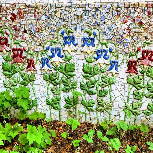 Tile mural in healing garden Santa Rosa CA Creativity Multi Colored Art And Craft Wall - Building Feature Architecture Wall Human Representation Pattern No People Plant Part Nature