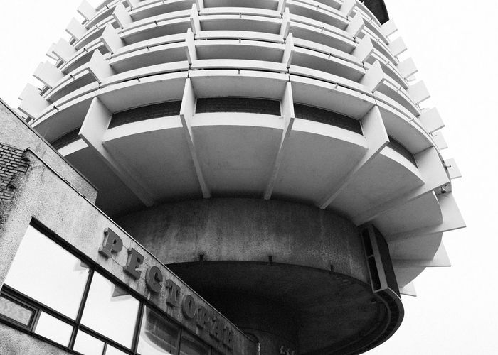 Brutalism in Kiev Black And White Brutal Architecture Building Exterior Post Soviet Rusty Metal SpaceShip Round Shape Concrete Old Restaurant Hotel Russian Linas Was Here