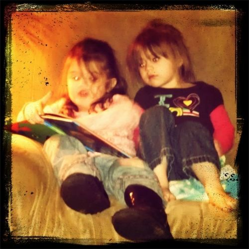 Gwyn reading a book to Bryanna, well trying to. I think she made the story a tad scary, lol