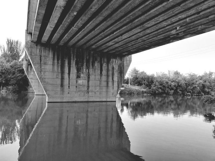 Under the bridge - Valladolid - Spain The Week on EyeEm Bridge Over Water Bridge View Structures And Architecture The Secret Spaces The Water Symmetry Lake Tree Reflection Sky Architecture Built Structure Building Exterior Bridge - Man Made Structure