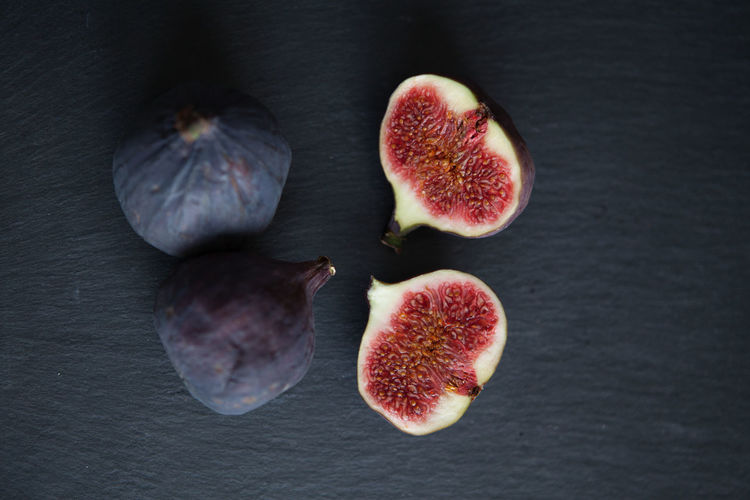 Fresh fruits, figs on a white background top view Fig Fruit Wellbeing Healthy Eating Freshness Still Life Food Food And Drink Indoors  No People Cross Section Group Of Objects Close-up Table Studio Shot SLICE Ripe High Angle View Halved Medium Group Of Objects Purple