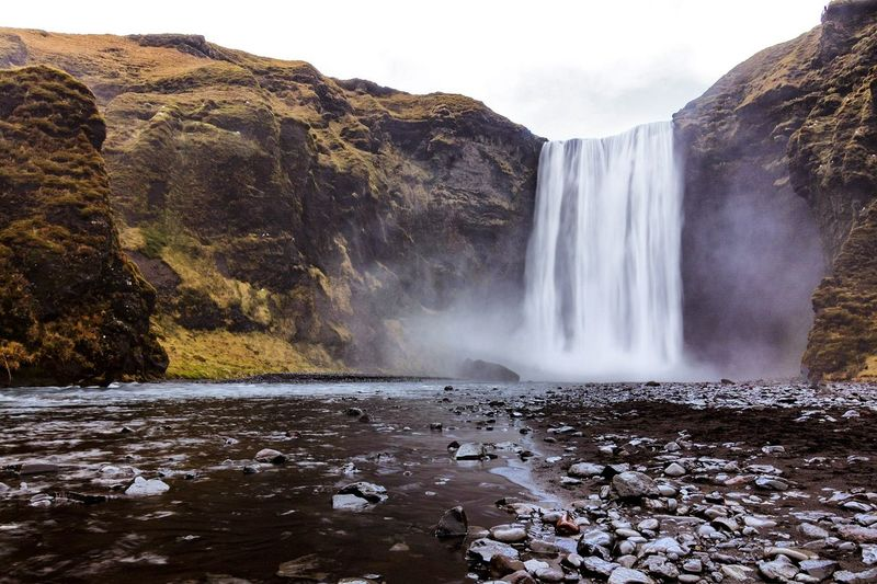 60 m high Iceland Liberty Travel Tranquility Fall EyeEm Selects Water Waterfall Power In Nature Motion Tree Rapid Long Exposure Cliff Sky Landscape Natural Landmark River Falling Water My Best Photo