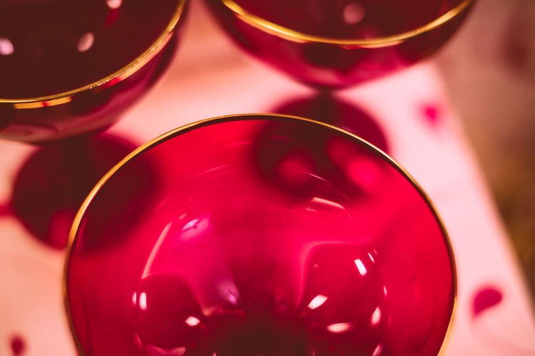 Cropped image of fresh red wineglasses
