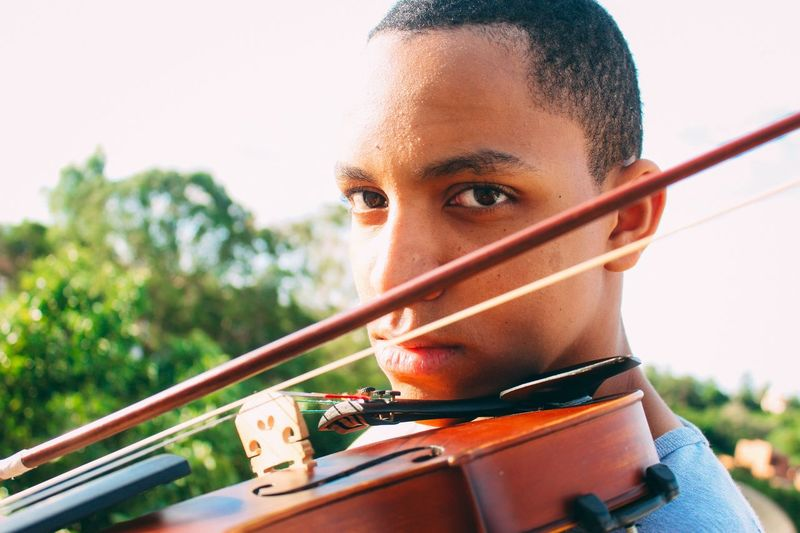 Portrait of teenage boy playing violin