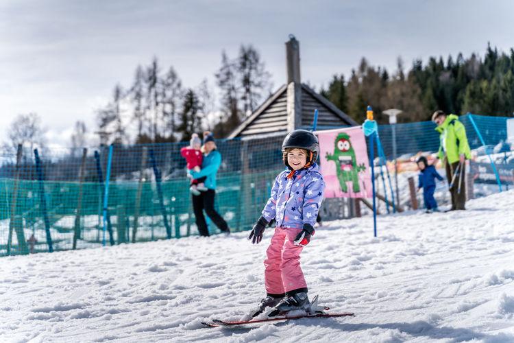 Full length of children on snow during winter