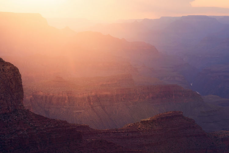 Sunset light spills through the grand canyon at navajo point in grand canyon national park, arizona.