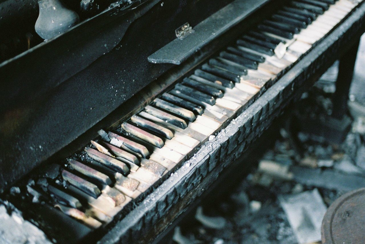 piano, musical equipment, musical instrument, music, piano key, old, close-up, arts culture and entertainment, keyboard, no people, keyboard instrument, abandoned, run-down, damaged, in a row, decline, high angle view, indoors, selective focus, focus on foreground, deterioration