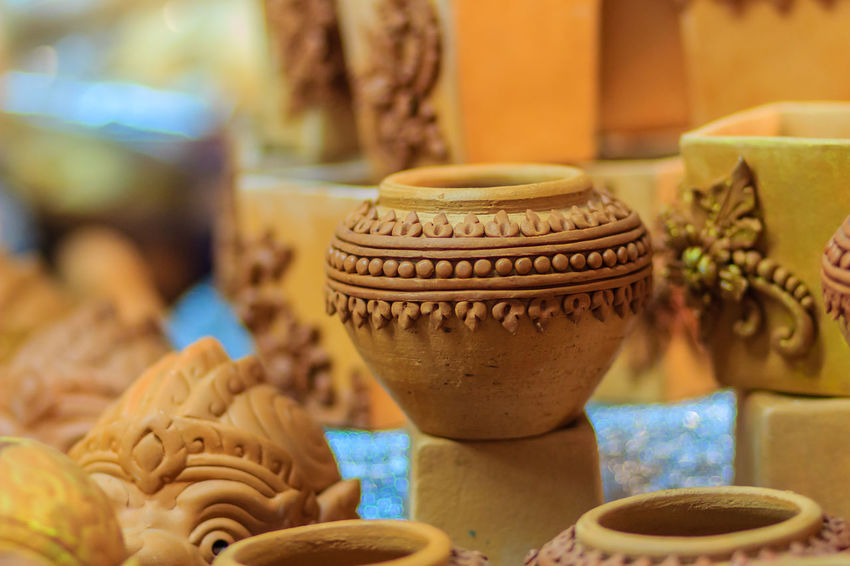 Beautiful handmade ceramic pot and vase in exotic patterns at night market. Ceramic Ceramic Art Ceramic Art Craft Clay Clay Art Clay Dolls Clay Work Close-up Day Focus On Foreground Freshness Hanuman Indoors  Jar No People Painting Sculptor