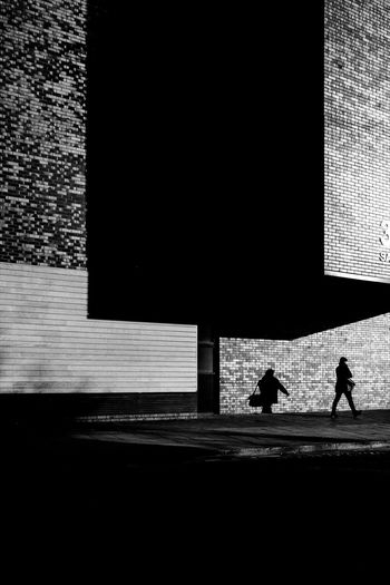 Manchester UK The Week on EyeEm Adult Architecture Black And White Building Exterior Built Structure City Dark Day Full Length Lifestyles Men Nature Outdoors People Real People Shadow Silhouette Street Street Photography Sunlight Transportation Walking Ways Of Seeing