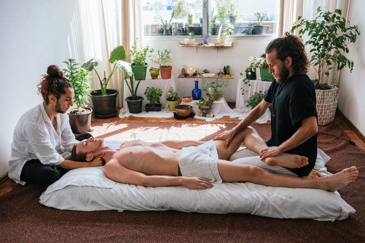 Men massaging customer at spa