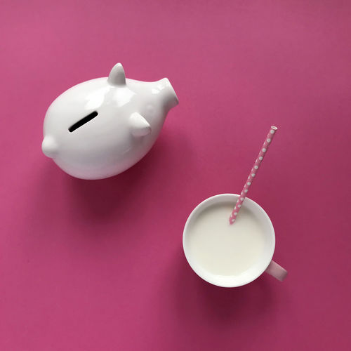 A box with a gift on a bright pink background. A cup of milk. Happy New Year! White pig-shaped piggy bank on a pink background with a cup of milk. 2019 year of the pig. Pink Color Studio Shot Piggy Bank Indoors  Colored Background Still Life No People Food And Drink White Color Investment Representation Pink Background Close-up Savings Animal Representation Finance Spoon Drink High Angle View Cup