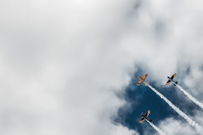 Aerobatics Air Vehicle Airplane Airshow Cloud - Sky Day Fighter Plane Flying Low Angle View Military Airplane Mode Of Transport No People Outdoors Sky Smoke - Physical Structure Teamwork Transportation Travel Vapor Trail
