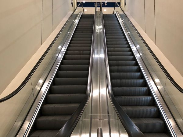 Lights Train Station Moving Syairs EyeEm Selects Staircase Steps And Staircases Convenience Architecture Indoors  Railing Technology Direction Transportation Escalator Illuminated The Way Forward Modern High Angle View Built Structure No People Connection Public Transportation Absence Moving Walkway