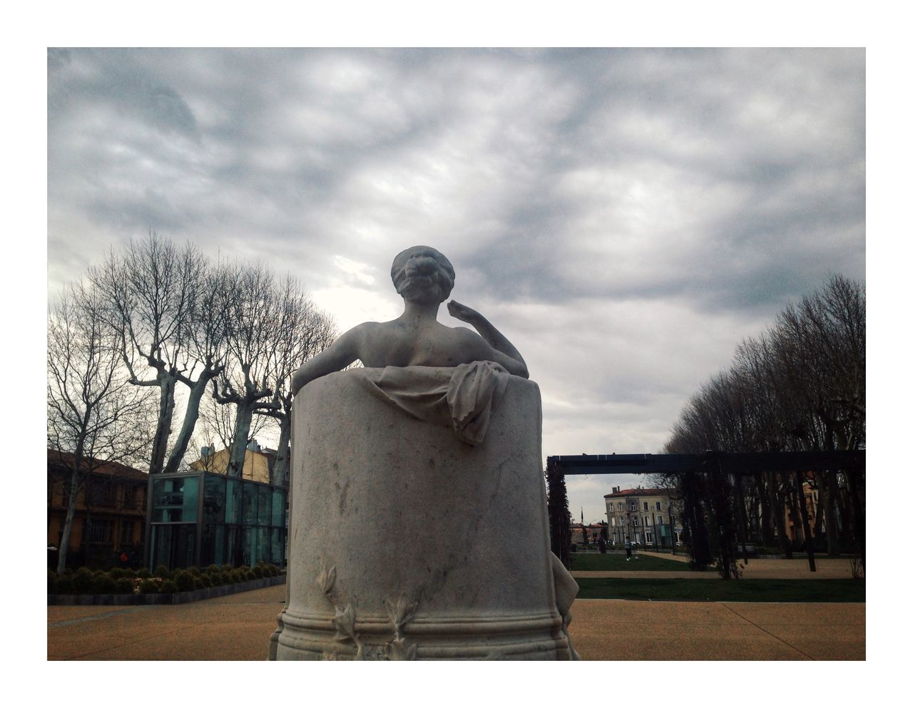 sculpture, cloud - sky, statue, human representation, sky, art and craft, auto post production filter, representation, transfer print, architecture, male likeness, creativity, built structure, tree, nature, day, no people, plant, female likeness, travel destinations, outdoors