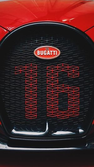 Chiron Bugatti Chiron Bugatti Red Text Communication Close-up Indoors  Car No People Motor Vehicle Transportation Sign Black Color Mode Of Transportation Guidance High Angle View Western Script Appliance Tail Light Land Vehicle Household Equipment