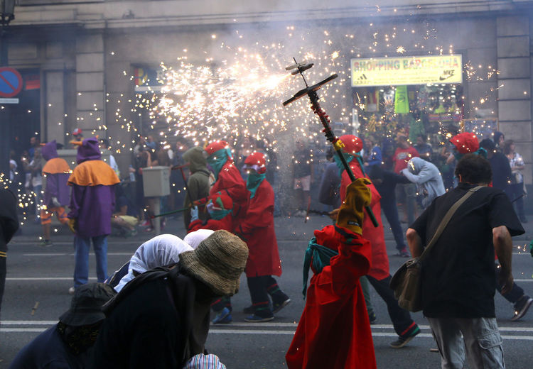 La Merce Barcelona Adult Arts Culture And Entertainment Celebration City Clothing Costume Crowd Event Festival Firework Firework - Man Made Object Firework Display Group Of People Large Group Of People Lifestyles Light Men Motion Outdoors Real People Street Women Focus On The Story