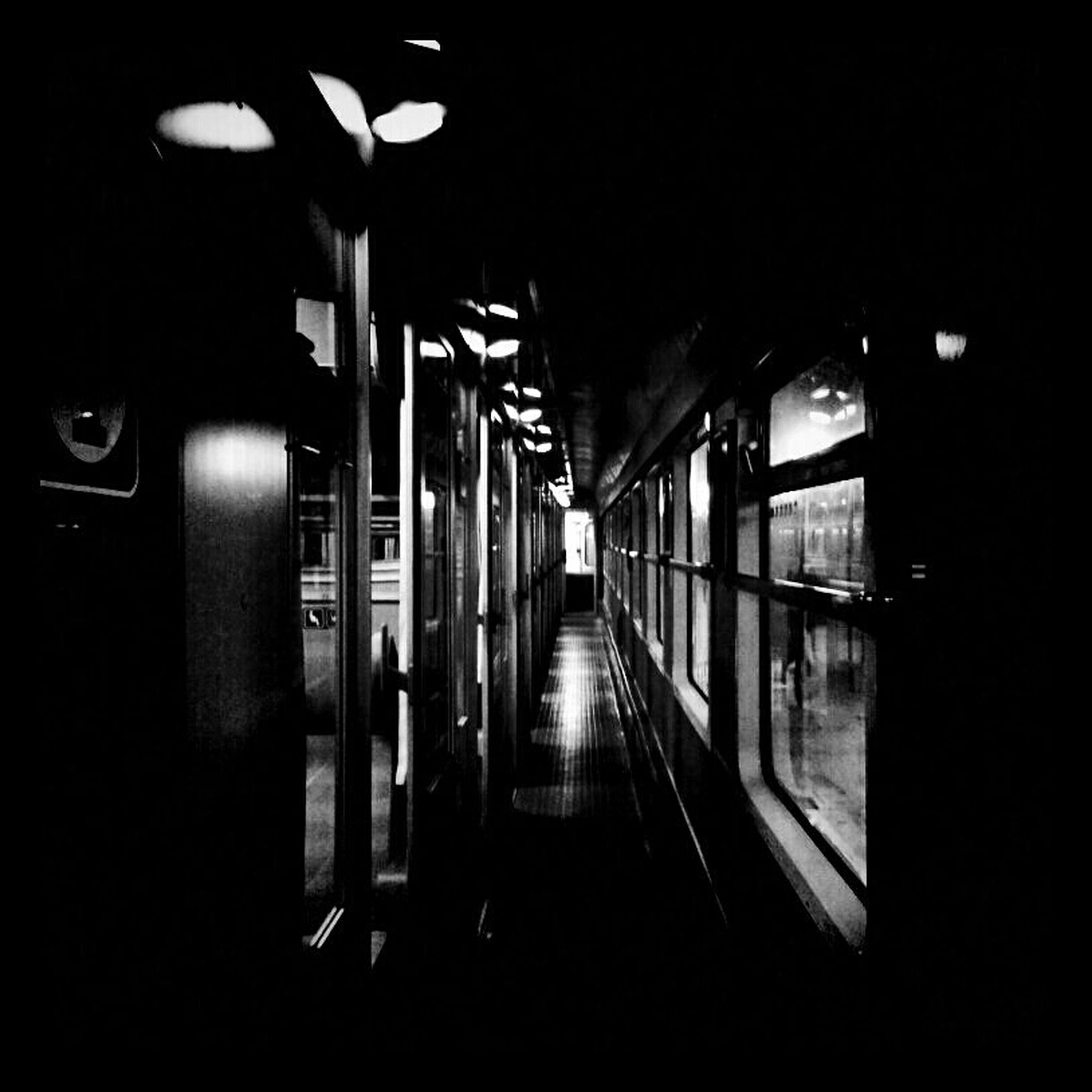 indoors, the way forward, illuminated, architecture, built structure, empty, transportation, night, corridor, diminishing perspective, dark, tunnel, absence, door, narrow, long, no people, subway, building, wall - building feature