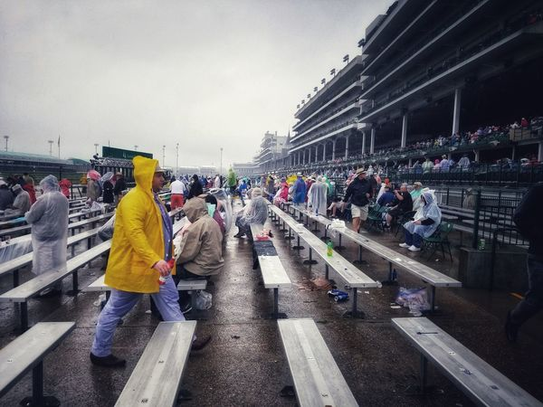 2018 Kentucky Derby, wettest derby in history. we were sopping wet by the end of the day and only picked one winner, still, it was a great atmosphere, and when the Race 12 came along you couldn't see the seating it was jam packed! Bright Colors Churchill Downs Kentucky Derby 2018 Louisville, Kentucky Wettest Derby Ever A Day At The Races A Splash Of Colour Built Structure Churchill Downs Clothing Crowd Dreary Day Grandstand Group Of People Large Group Of People Ode To Abbey Road Real People Samsung Galaxy S8+ Samsungphotography Yellow