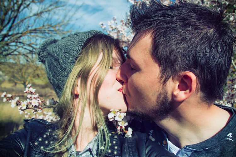 Close-Up Of Couple Kissing At Park