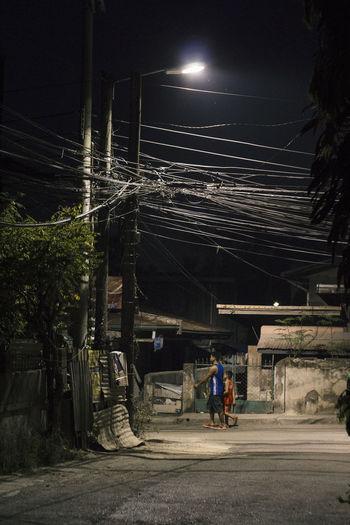 Men on illuminated street at night