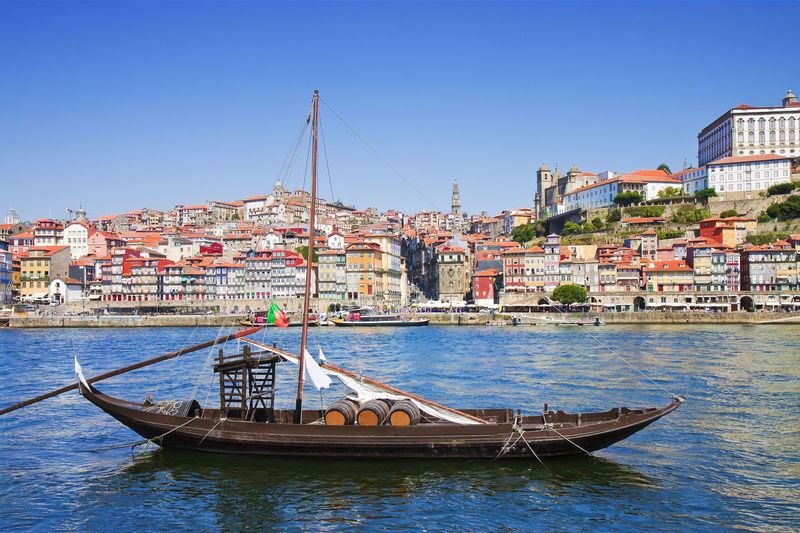 """Typical portuguese wooden boats, in portuguese called """"barcos rabelos"""", used in the past to transport the famous port wine (Portugal) Douro River Portugal Oporto City Oporto, Portugal Portugal Tradition Wooden Boat Barcos Rabelos Barrel Barrel Boat Boats And Water Douro River, Douro Valley Portuguese Culture Wine"""