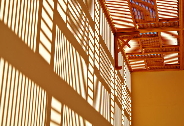 Architecture Background Bright Sunshine Built Structure Copy Space Day Gold Colored Indoors  Lines Lines And Shapes Low Angle View No People Rectangles Reflections Reflections On The Wall Paint The Town Yellow