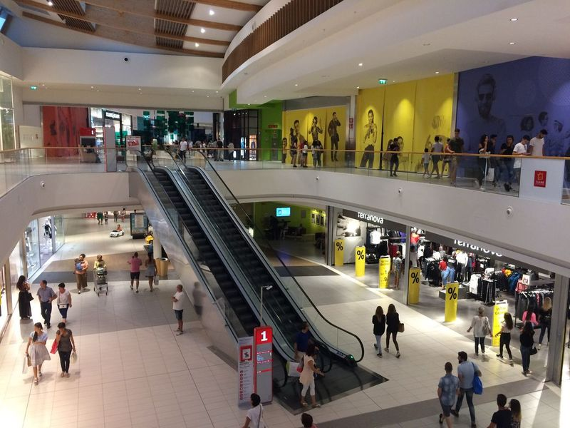 Large Group Of People Real People Architecture Men Modern Lifestyles Women Walking Indoors  IndoorPhotography Shopping Mall Staircase Built Structure Illuminated High Angle View Leisure Activity Steps And Staircases Architectural Column Crowd Day People Adult Adults Only