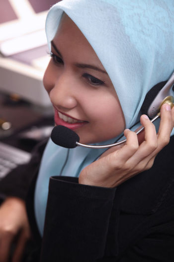 Female customer service representative working in office
