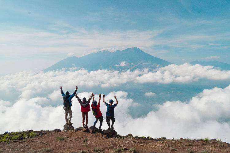 Cloud - Sky Sky Group Of People Mountain Human Arm Leisure Activity Real People Scenics - Nature Standing Full Length Nature Togetherness Men Arms Raised Women Beauty In Nature Day People Lifestyles Tranquil Scene Mountain Range Limb Outdoors
