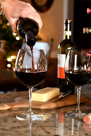 Pouring glasses of red wine to go with fresh bread and cheese Merlot Red Wine Wine Glass Alcohol Bread Cheese Chianti Close-up Day Drink Entertaining At Home Food Food And Drink Freshness Indoors  Party Red Wine Refreshment Wine Wine Bottles Wineglass