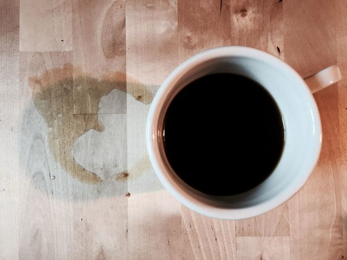 Close-Up Of Black Coffee Served On Table