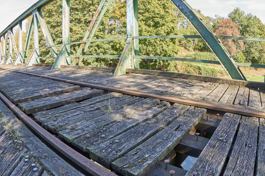 Railway Bridge Abandoned Architecture Bench Bridge Built Structure Day Empty Growth High Angle View Metal Nature No People Obsolete Old Outdoors Plant Plant Part Railing Railway Railway Bridge Seat Tree Wood - Material