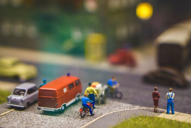 Miniature land Miniature Minimalism Toy Childhood Toy Car People Transportation Day Focus On Foreground City Child Selective Focus Men Mode Of Transportation Tilt-shift Car Leisure Activity Architecture Building Exterior Real People Offspring Street