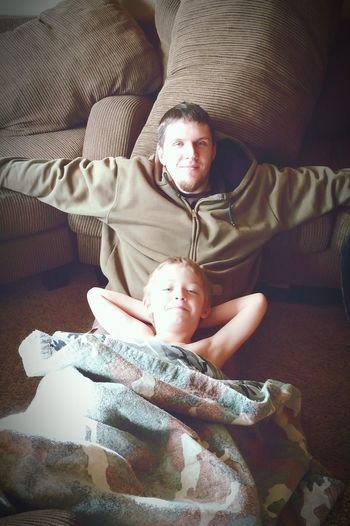 Dad and his sick boy. Just chilling watching walking dead.