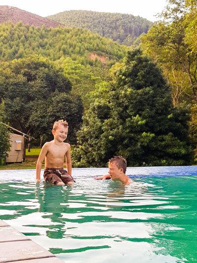 Brothers enjoying in pool