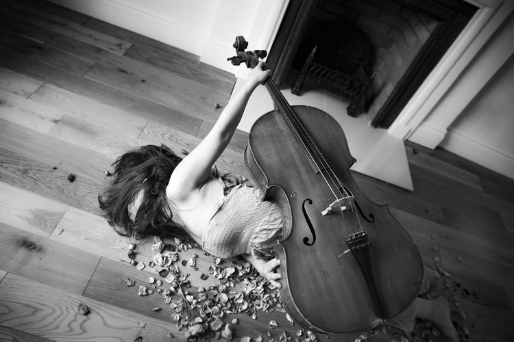 Cello Classical Music High Angle View Human Hand Indoors  Music Musical Instrument Musical Instrument String Musician Performance Real People Young Women The Week On EyeEm Expression Emotions Hiding Woman Long Hair Black And White Friday Visual Creativity Visual Creativity Focus On The Story Creative Space The Portraitist - 2018 EyeEm Awards Autumn Mood