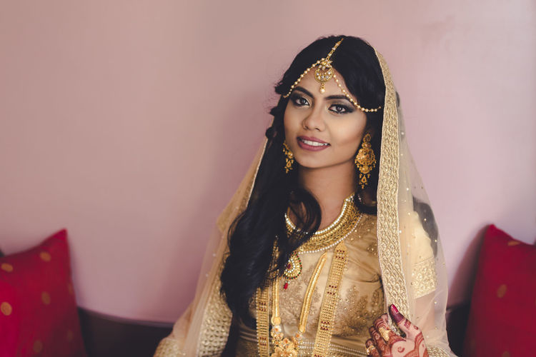Portrait of beautiful bride with traditional dress