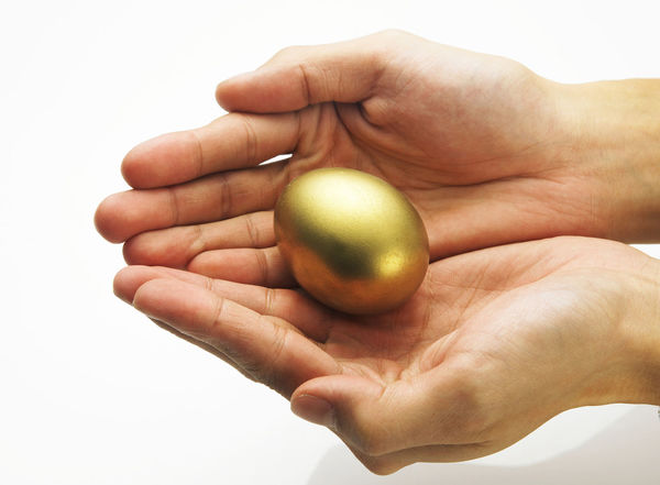Investing in Quality of Life Rich Abstract Careful Concept Golden Egg Holding Human Body Part Human Finger Human Hand Investment Protection Studio Shot Wealth White Background
