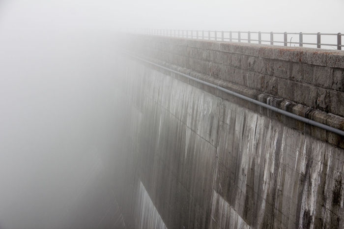 Dam at Räterichsbodensee with clouds rolling up Grimsel Valley, Berner Oberland, Switzerland Architecture Background Disappearing Clouds Clouds Rolling In Dam Fog Grey Grey Day Leading Lines Masonry No People Poor Visibility Structures & Lines Visibility Wall The Secret Spaces