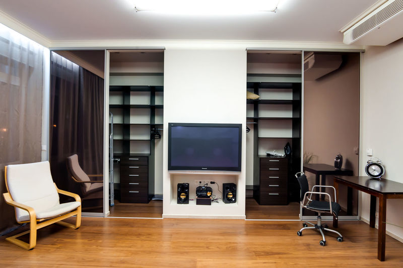Flooring Home Interior Modern Indoors  Hardwood Floor Home Wood Furniture Home Showcase Interior Domestic Room Luxury Wealth Architecture Wood - Material Seat Technology Design Building Chair Living Room No People Apartment Clean Flat Screen