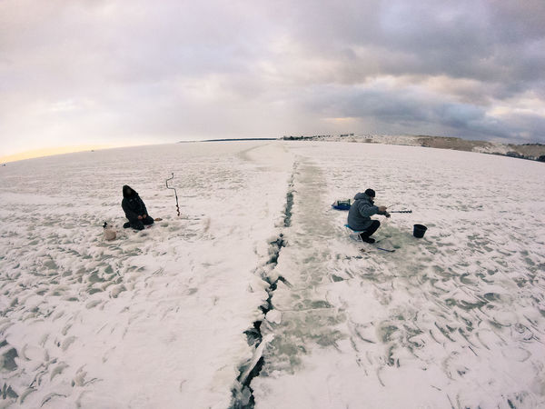 Fishermen on ice in Nida, Lithuania Baltic Baltic Sea Curonian Lagoon Curonian Spit Dunes Frozen Frozen Sea Nida Lithuania Winter Beauty In Nature Cloud - Sky Cold Day Fisherman Fisherman Boat Fishing Fishing On Ice Nature Neringa Nida Outdoors People Real People Scenics Sky