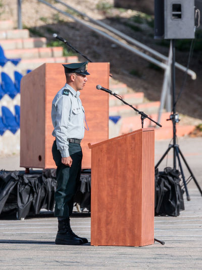 Mishmar David, Israel, Februar 21, 2018 : Ensign of the IDF stands near the podium at the formation in Engineering Corps Fallen Memorial Monument in Mishmar David, Israel Engineering Corps Fallen Memorial Monument Event Formation Officer Patriotism Soldier Soldiers Standing Uniform Warrior Armed Army Ceremony Combat Day Education Idf Infantry Israel Military Parade People person Professional Training