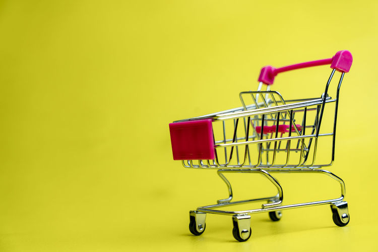 empty cart on yellow background for online shopping sale moment Cart Shopping Bag Business Empty Finance Metal Colored Background Studio Shot Buying Indoors  No People Supermarket Copy Space Consumerism Store Shopping Shopping Cart Shopping Basket Push Cart Sale Retail  Clean Summer Sale Design Sale And Purchase Online Shopping